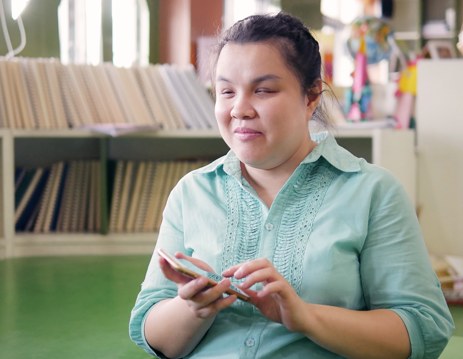 Woman using voice over to type on her smartphone