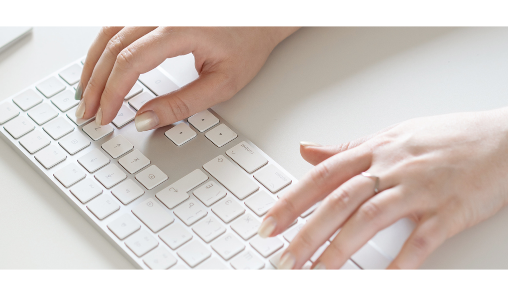 hands of a person typing on the computer